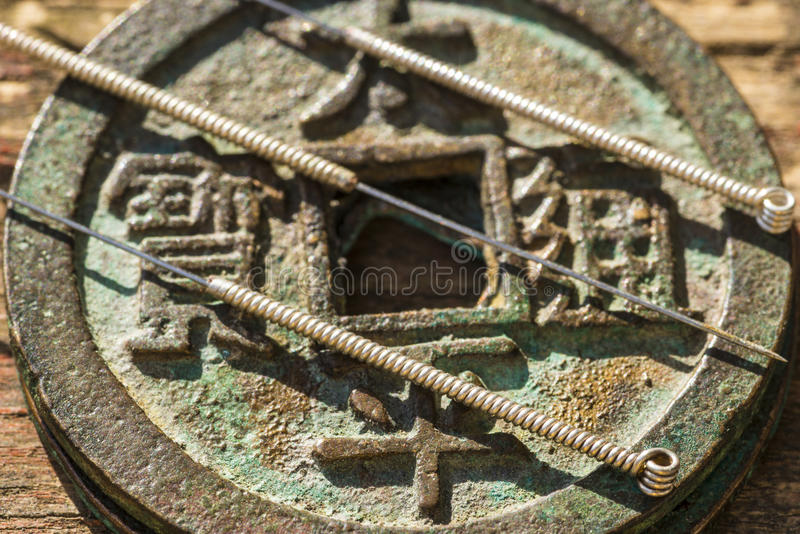Acupuncture needles and antique chinese coin. Acupuncture needles with antique chinese coin stock image