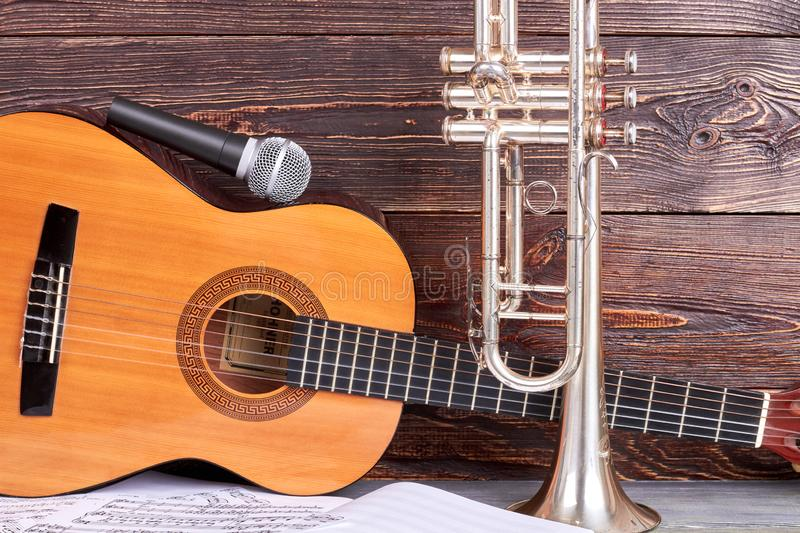 Acustic guitar, microphone and trumpet. stock photography
