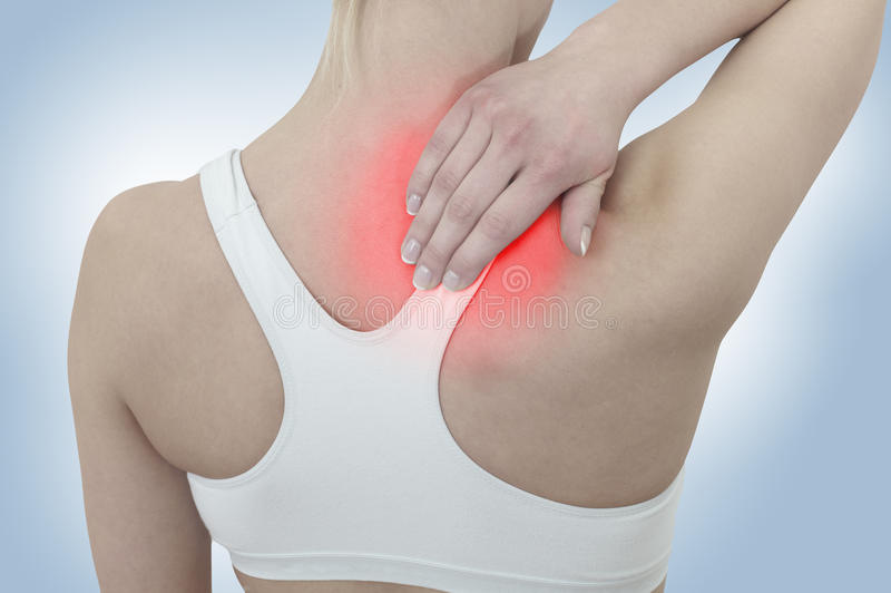 Acute pain in a woman neck stock photos