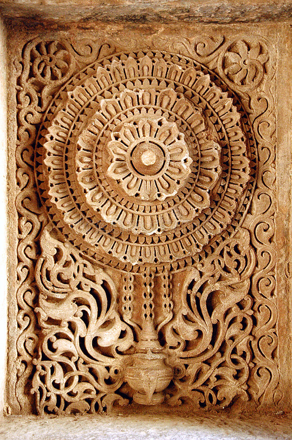 Adalaj step well, ahmadabad. Beautiful stone carving at adalaj step well situated at ahmadabad, India. ancient art found in stone carving stock photography