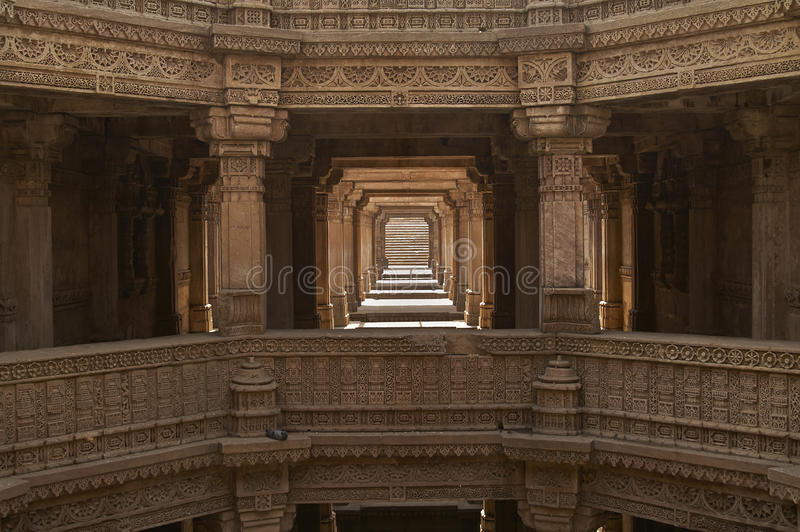 Adalaj Stepwell, Ahmadabad, Gujarat, India. Ornately carved stonework of the Adalaj Stepwell on the outskirts of Ahmadabad, Gujarat, India. Built circa 1499 stock photography