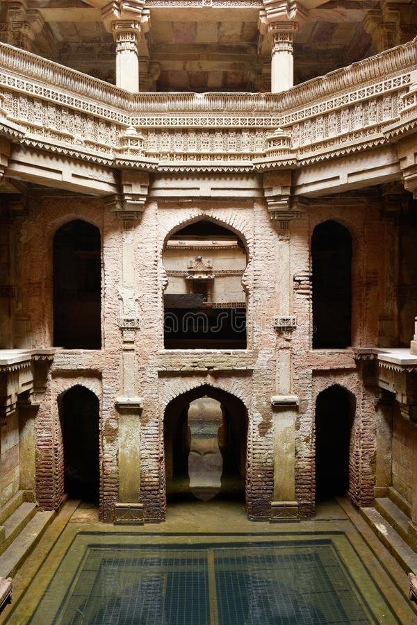 Adalaj Stepwell in Ahmadabad, India. India, Adalaj Stepwell is a Hindu water building in the village of Adalaj, close to Ahmedabad town in the Indian state of stock images