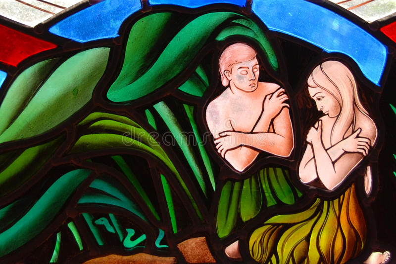 Adam and Eve. Stained Glass window segment of Adam and Eve in the Garden of Eden