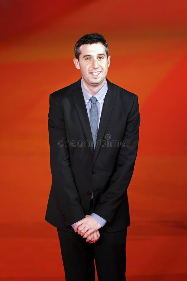 Adam Leon no tapete vermelho foto de stock