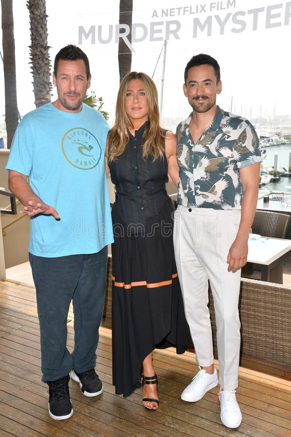 Adam Sandler, Jennifer Aniston & Luis Gerardo Mendez. LOS ANGELES, USA. June 11, 2019: Adam Sandler, Jennifer Aniston & Luis Gerardo Mendez at the photocall for royalty free stock photography