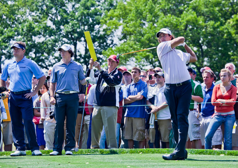 Adam Scott, Lee Westwood and Rory McIlroy. FARMINGDALE, NY - JUNE 15: Adam Scott hits his drive while Lee Westwood and Rory McIlroy look on during the 2009 US royalty free stock photography
