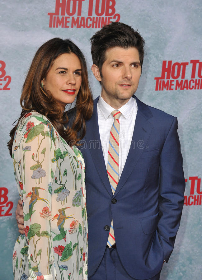 Adam Scott & Naomi Scott. LOS ANGELES, CA - FEBRUARY 18, 2015: Adam Scott & wife Naomi Scott at the Los Angeles premiere of his movie Hot Tub Time Machine 2 at royalty free stock photos