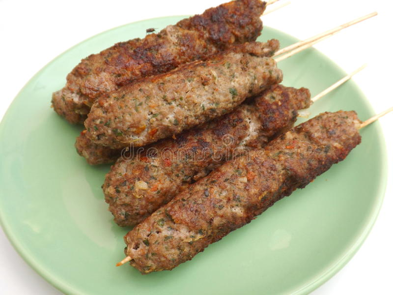 Adana kebab. Some fresh adana kebab meat on a plate royalty free stock photo