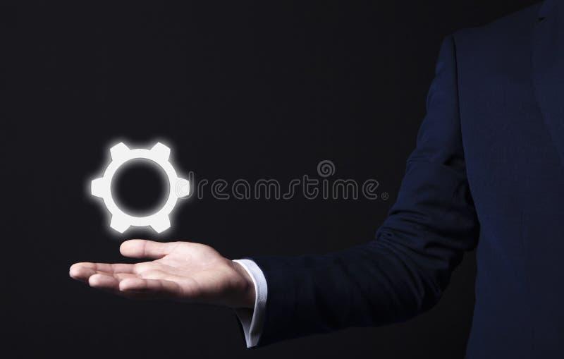 Adapta el icono en mano del hombre de negocios foto de archivo libre de regalías