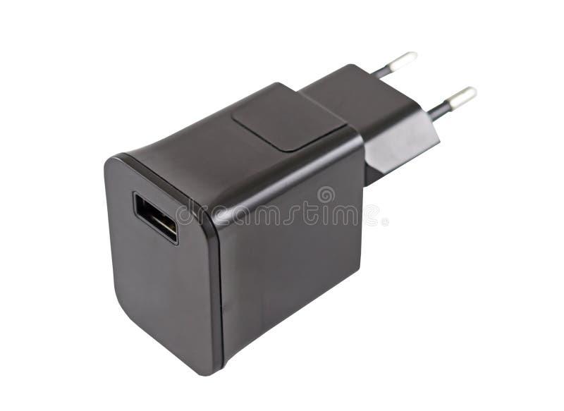 Adaptador de corriente alterna para cargar el teléfono fotografía de archivo libre de regalías