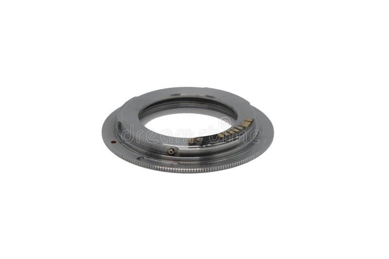 Adaptador do anel para a lente em um fundo branco fotografia de stock