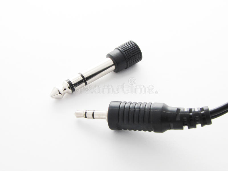 Adaptador para a conexão audio de dispositivos diferentes imagem de stock
