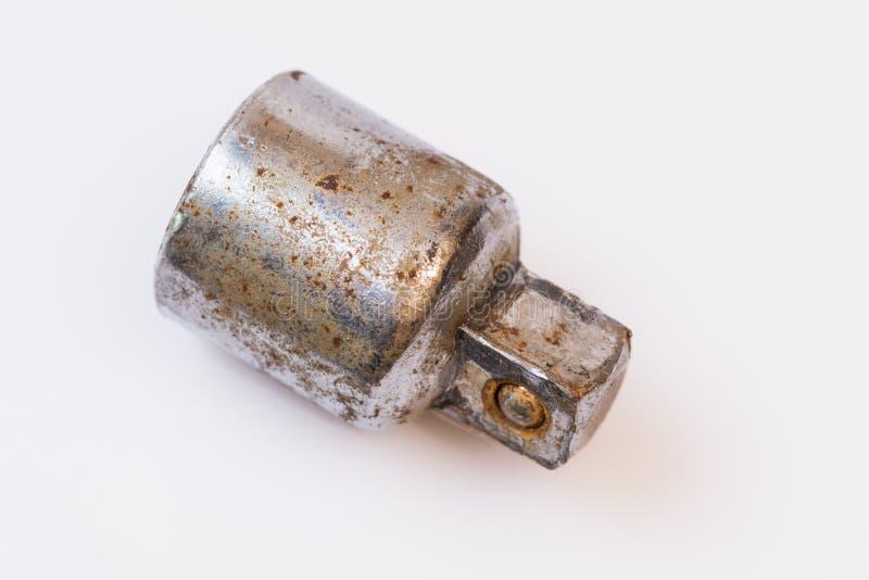 Adaptateur utilisé rouillé de clé à douille photographie stock