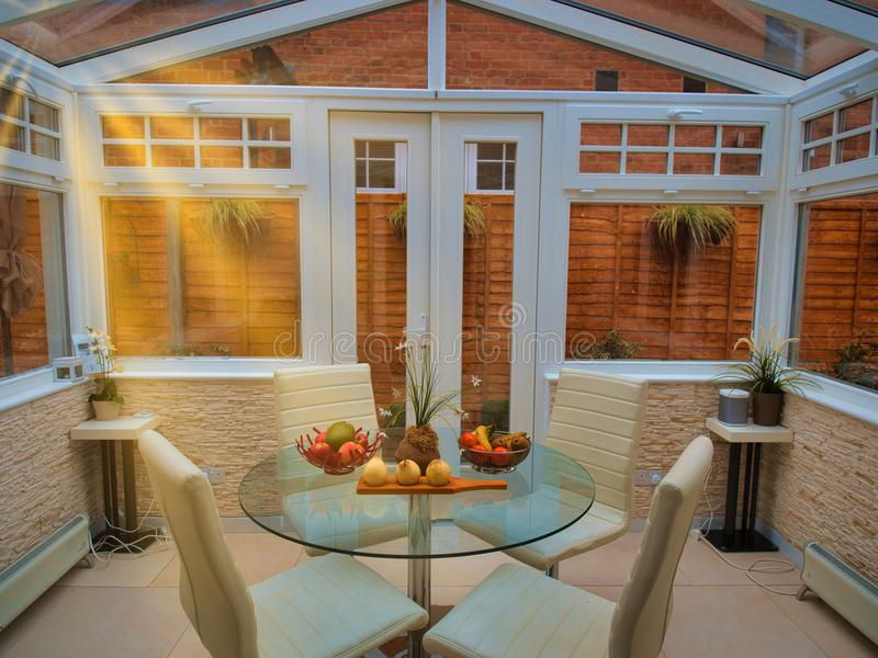 An adapted coach house conservatory, english garden suburb royalty free stock image