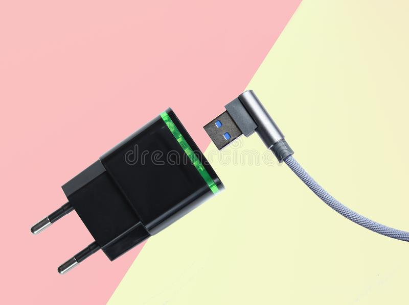 Adapter for charging smartphone, usb cable royalty free stock photos