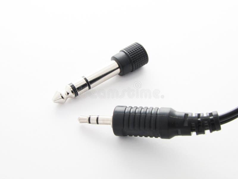 Adapter für Audioverbindung von verschiedenen Geräten stockbild