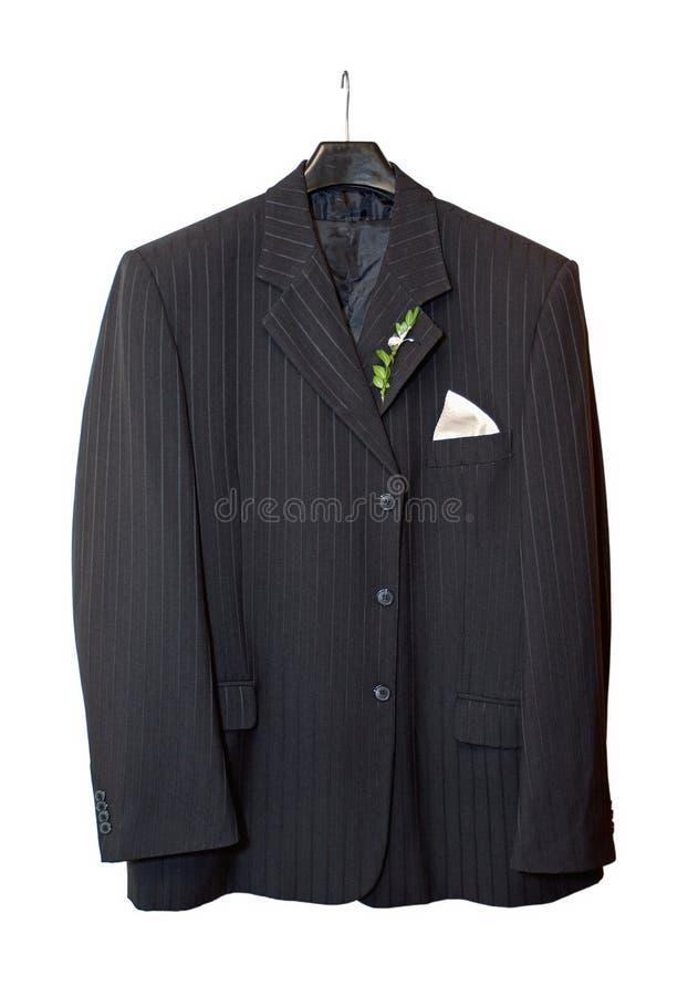 Adaptez à la jupe s'arrêtant sur une bride de fixation avec un boutonniere image stock