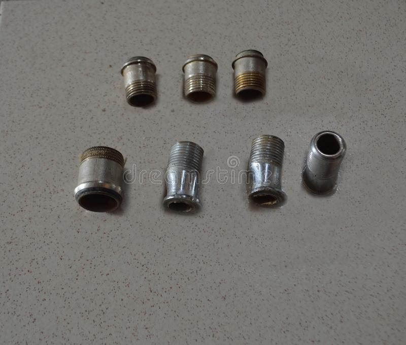 Adaptor bathroom brass compression fittings connection copper tube ,coupling. A lot of fittings isolated or adaptor bathroom brass,compression fittings stock photos