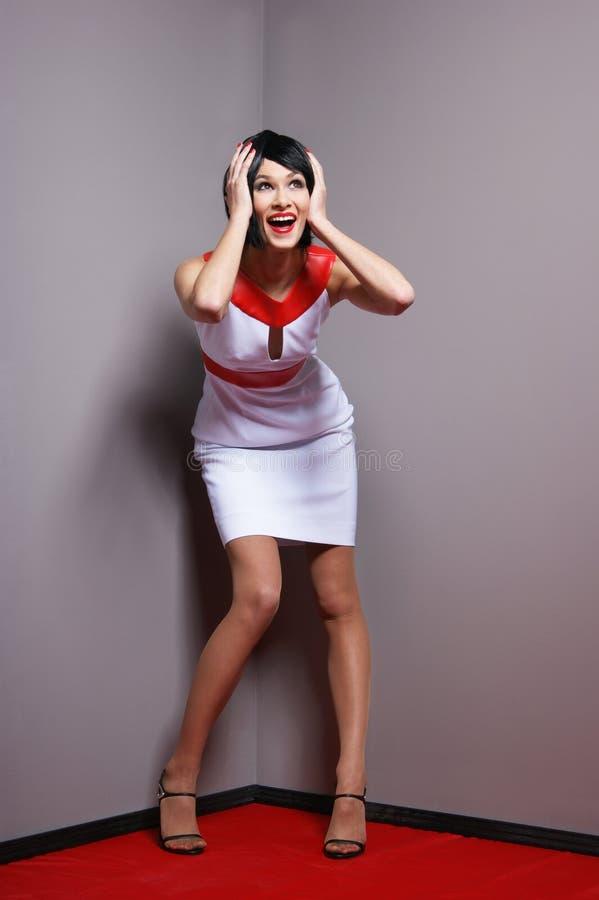 Adatti il tiro di una donna in un bello vestito immagini stock libere da diritti