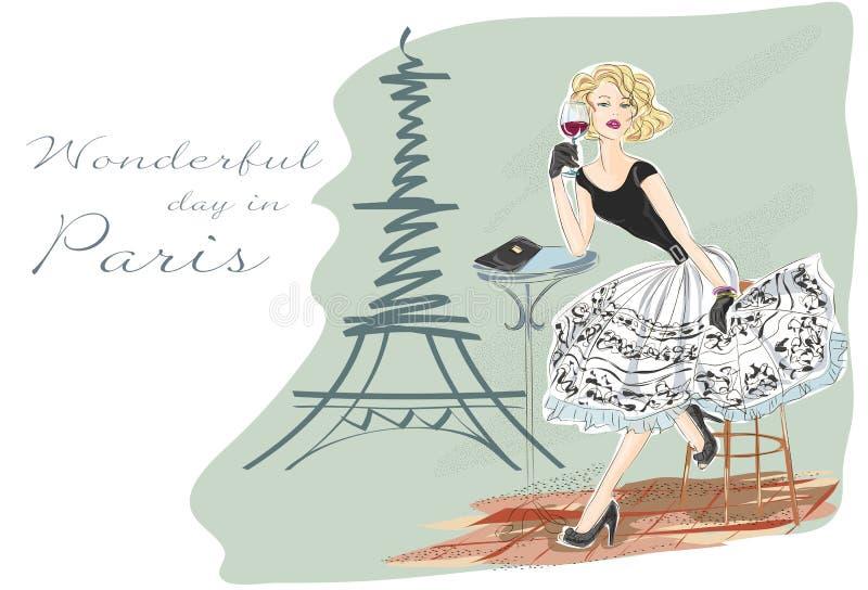 Adatti la ragazza con vetro di vino rosso che si siede vicino alla torre Eiffel fotografia stock