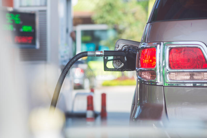Add fuel car in gas station royalty free stock image