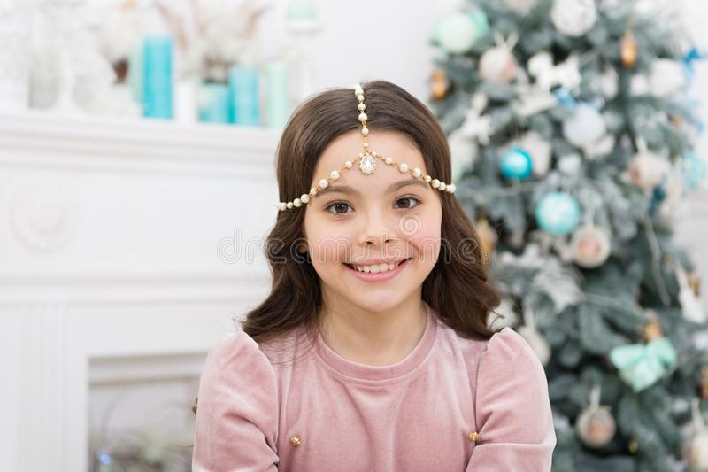 Add some glitz and glam to your look. Happy girl smile with Christmas look. New year eve party look of small child. Give royalty free stock images