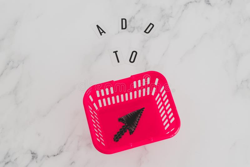 Add to cart concept, message on desk with shopping basket and mouse pointer icon inside. Add to cart and online shopping concept, message on desk with shopping royalty free stock photo