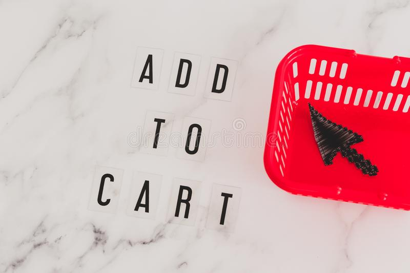 Add to cart concept, message on desk with shopping basket and mouse pointer icon inside. Add to cart and online shopping concept, message on desk with shopping stock photos