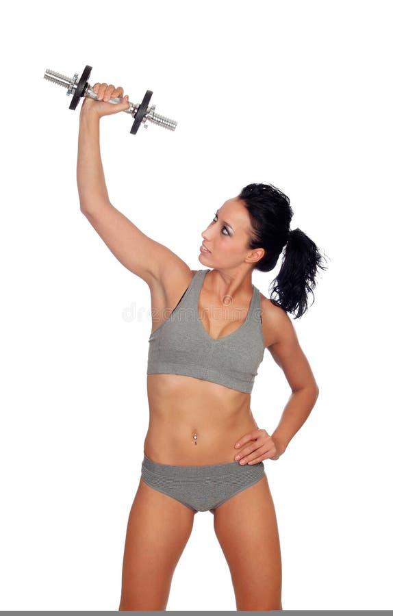 Addestramento attraente della ragazza con le teste di legno fotografia stock libera da diritti