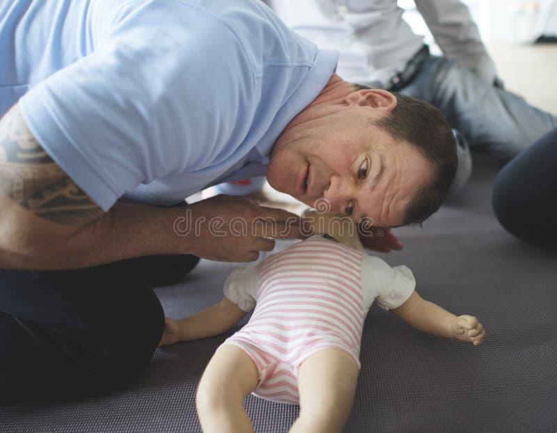 Addestramento del pronto soccorso di CPR del bambino fotografia stock libera da diritti