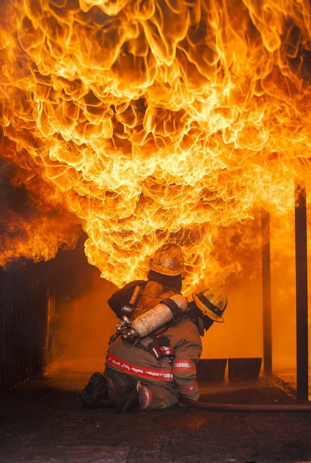 Addestramento di estinzione di incendio immagini stock