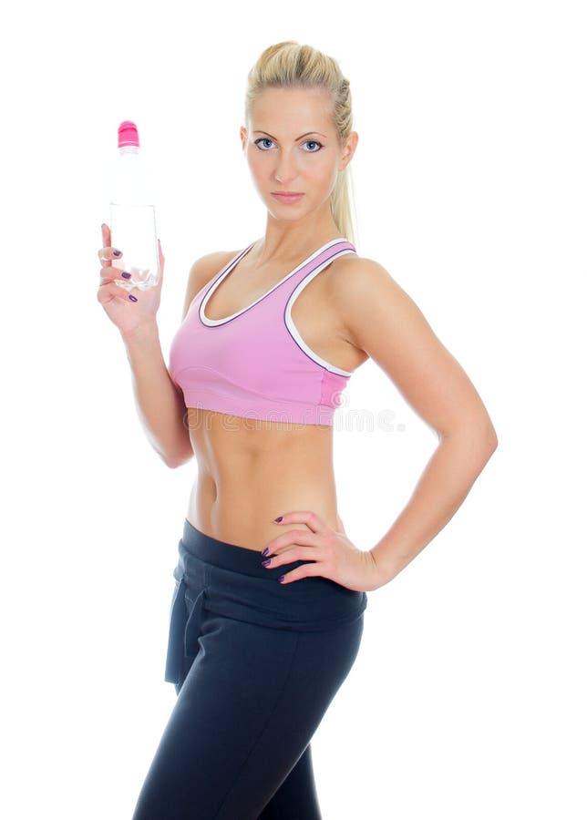 Addestratore femminile abbastanza giovane di forma fisica immagine stock