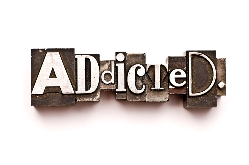 Addicted. The word Addicted photographed using vintage letterpress type stock images