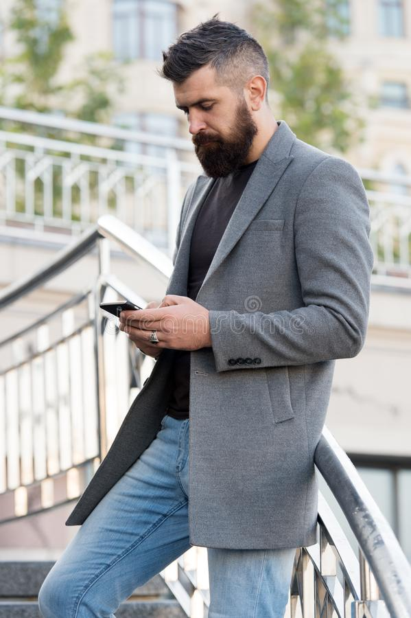 Addicted concept. Social networks dependence. Busy man use mobile phone outdoors. Social media time tracker provide. Detailed information how many times day stock photo