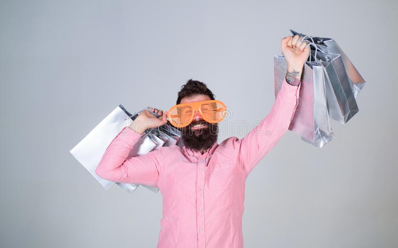 Addicted consumer concept. Man bearded hold shopping bags. Shopping dumb wasting money. Stupid things you do with your. Money. How to stop buying things you royalty free stock photos
