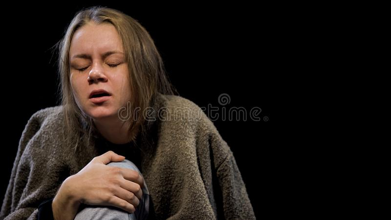 Addicted person suffering drug withdrawal symptom, pain expression on face stock photography