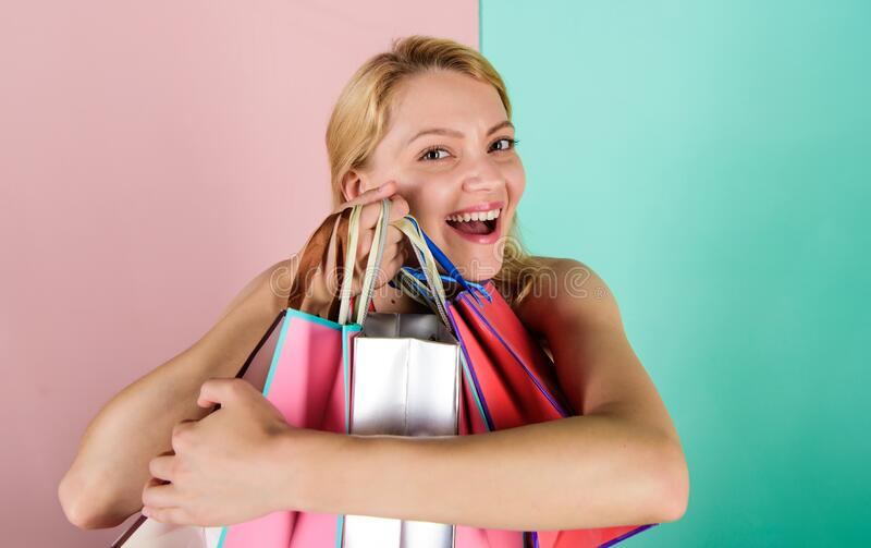 Addicted shopaholic girl. Shopping therapy. Buy gifts. Woman on shopping tour. Discounts and loyalty program. Girl with stock photos