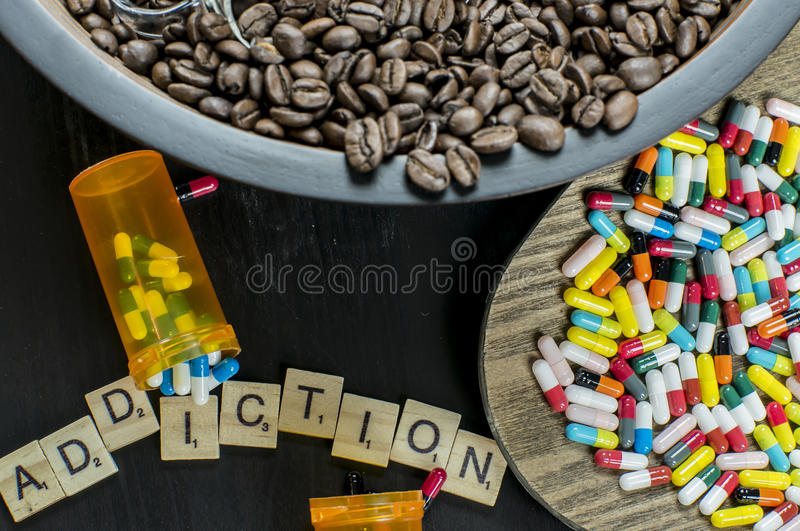 Addiction to coffee and drugs stock images
