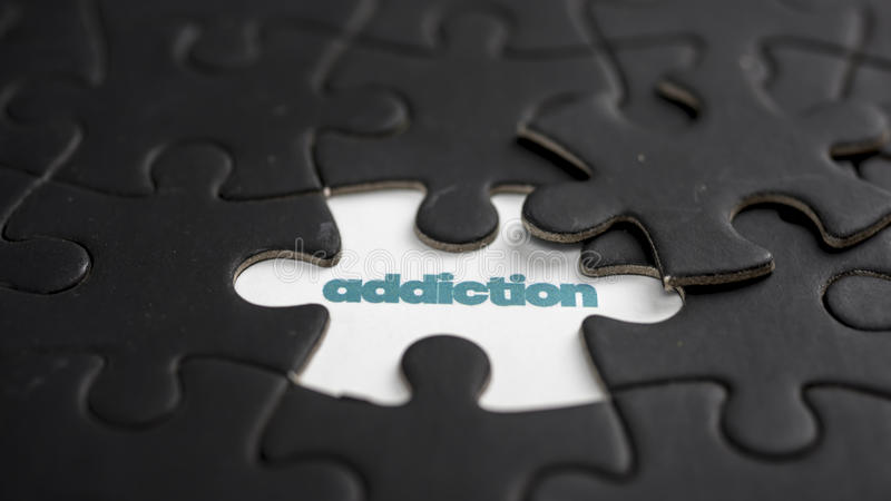 Addiction. Word addiction under jigsaw puzzle piece stock image