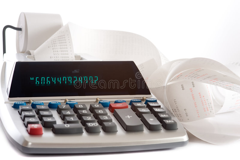 Adding Machine. An adding machine or calculator with adding machine tape or paper royalty free stock images
