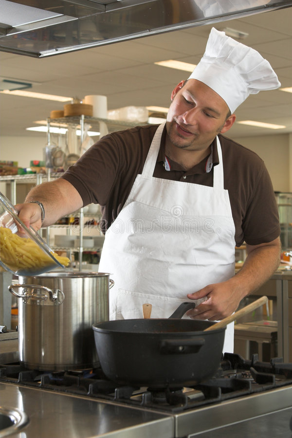 Adding the pasta stock photos