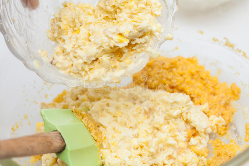 Adding shredded corn kernels to prepare sweet corn bread. Traditional Colombian Arepa de Choclo Preparation : Adding shredded corn kernels to prepare sweet corn royalty free stock image