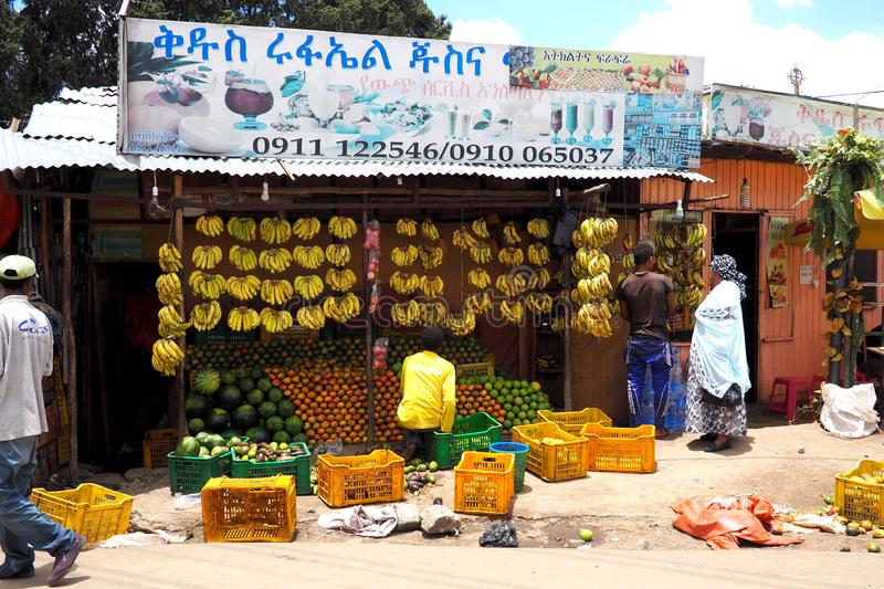 Addis Ababa, Ethiopia - 14 April 2019 : Busy street in the Ethiopian capital city of Addis Ababa. Addis Ababa, Ethiopia - 14 April 2019 :  Street traders in the royalty free stock photo