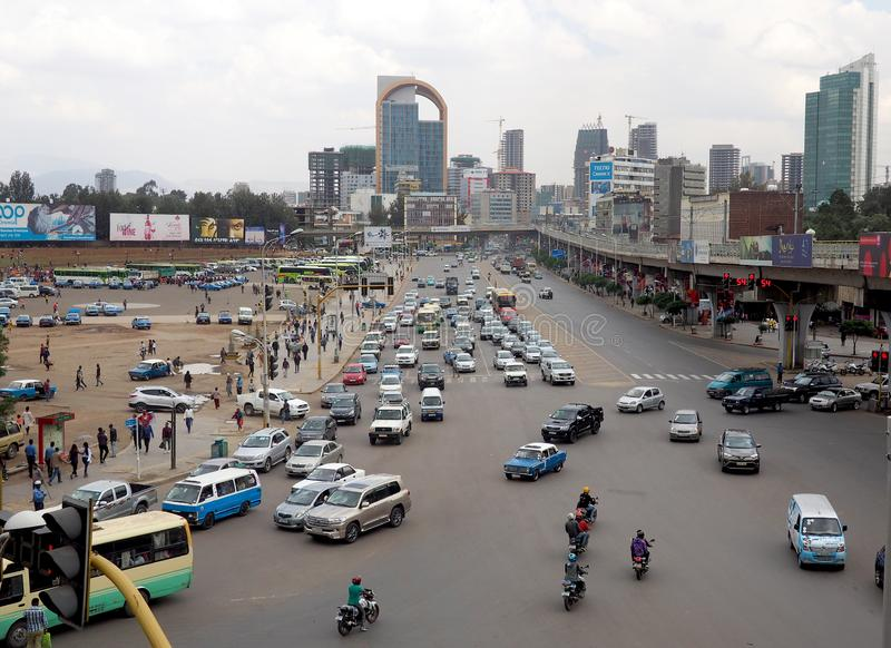 Addis Ababa, Ethiopia - 11 April 2019 : Busy street in the Ethiopian capital city of Addis Ababa. Addis Ababa, Ethiopia - 18 April 2019 : Busy street and skyline stock image