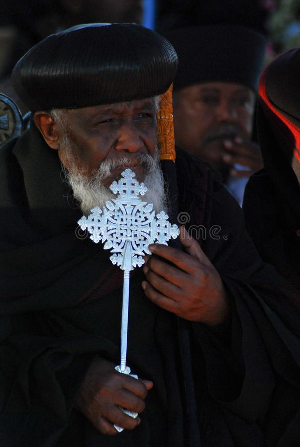 Addis Ababa, Ethiopia: Portrait of Ethiopian Orthodox Priest holding cross royalty free stock images