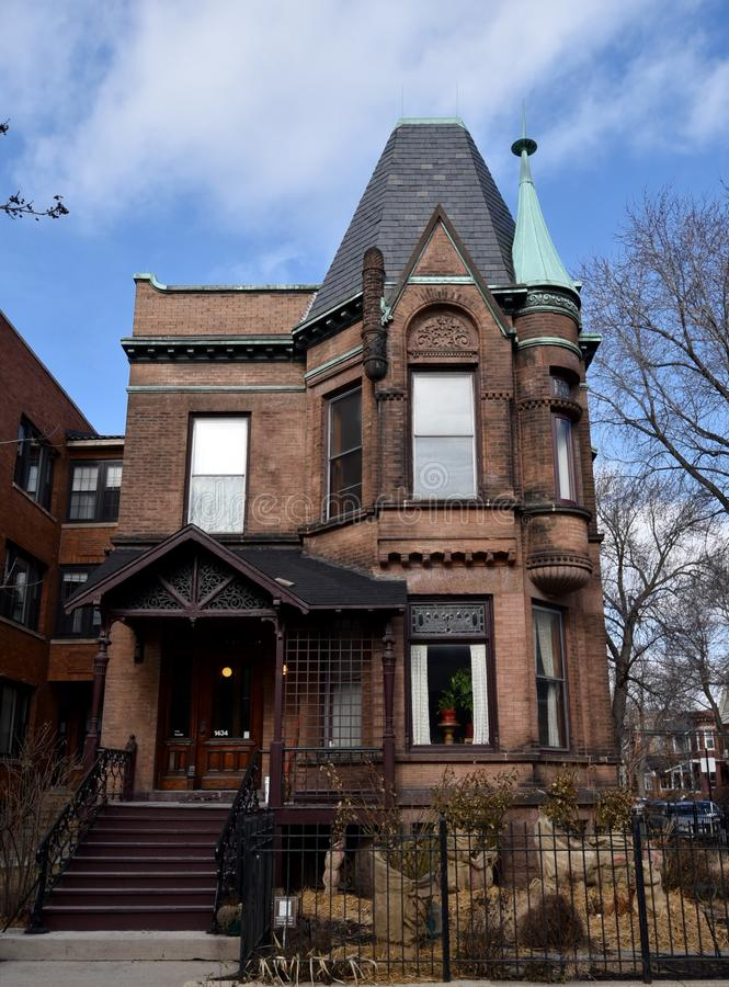 Addison Street Italianate. This is a Winter picture of a house in the Wrigleyville Neighborhood located in Chicago, Illinois. This house built in 1896 is an royalty free stock photos