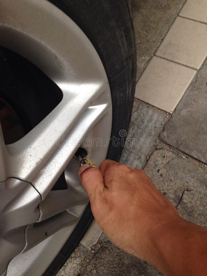 Additional pneumatic tire. Hand is additional pneumatic tire stock photo