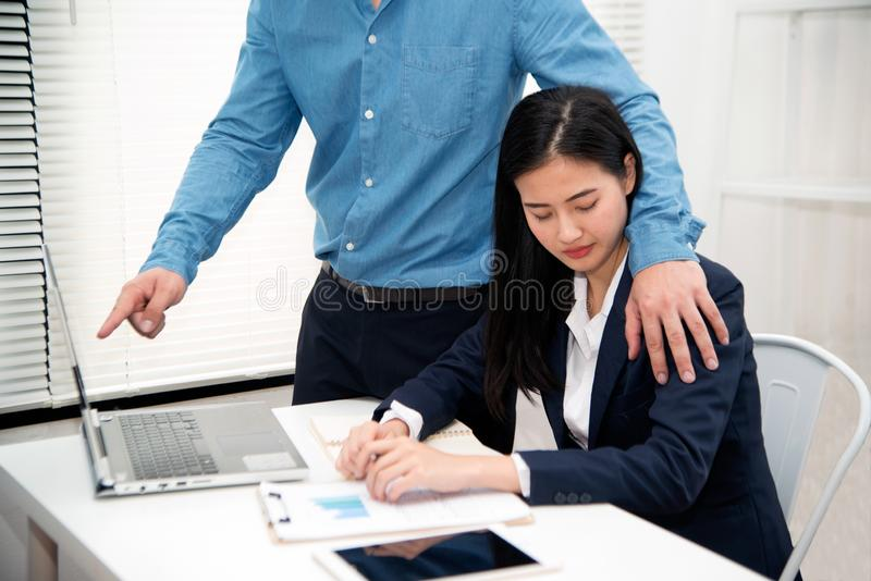 Addressing workplace sexual harassment is Asian pretty woman secretary suffer assault and harassment from boss is a Harassment and. Addressing workplace sexual royalty free stock photos