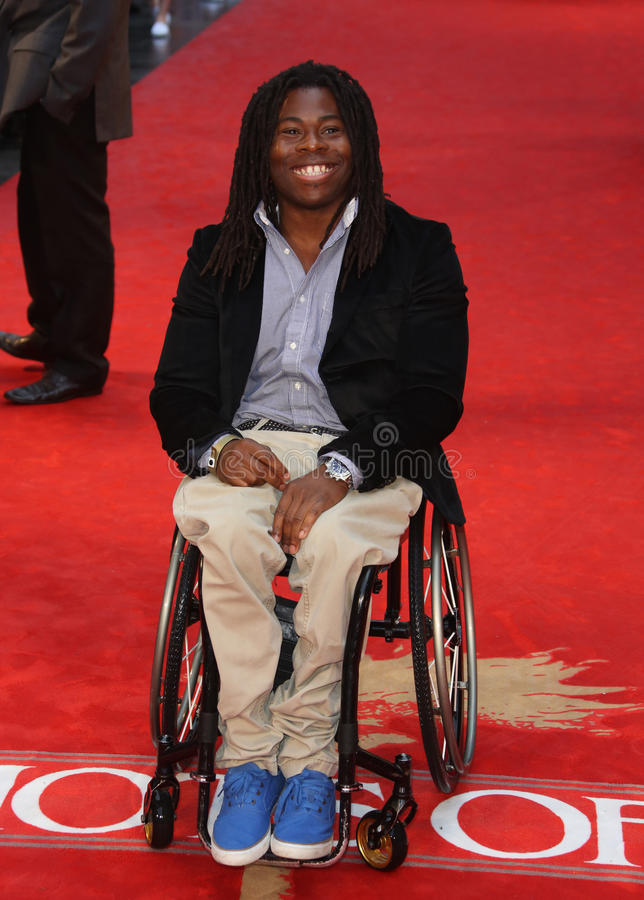 Ade Adepitan. Arriving for the Chariots of Fire Premiere held at the Empire Leicester Square - London, England. 10/07/2012 Picture by: Henry Harris / stock photography