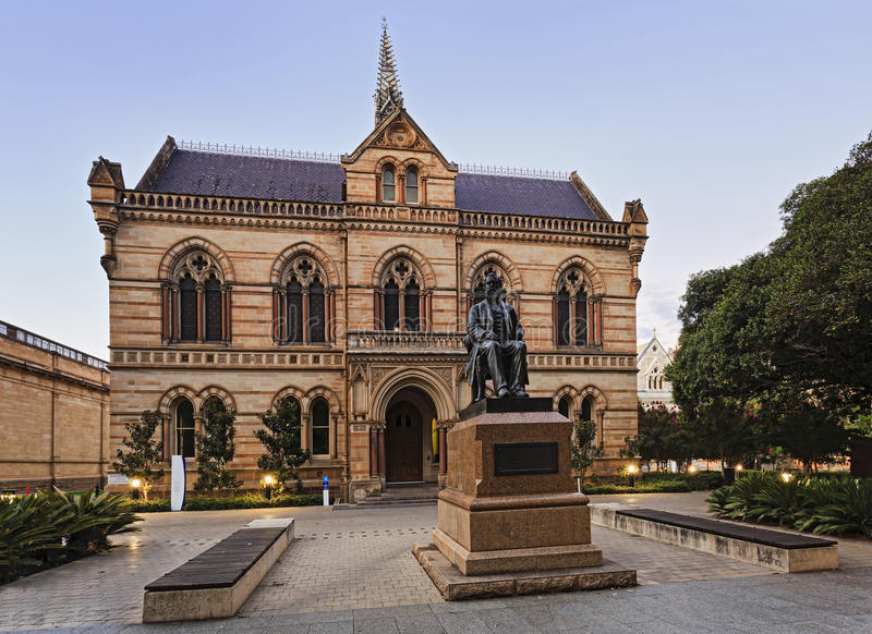 ADE Archeology museum. Facade of Adelaide public servcies building- museum of Archeology with the status of Walter Hughes at the entrance. Historic building stock images